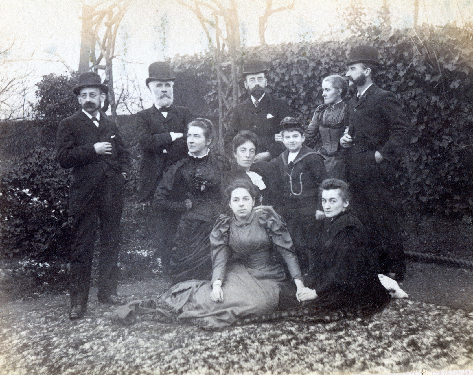Left to right: (back) Fred Enock, Henry Dell (brother-in-law), Robinson Enock (brother), Emily Enock (Edwin's wife), Edwin Enock (brother), (middle) Jennie Enock (Fred's wife), Eleanor Enock (Robinson's wife), Roy Enock (Edwin and Emily's son) (front) Amy Dell (Henry Dell's daughter), Jane Enock (Fred's nephew, Guy Enock's wife) c1891